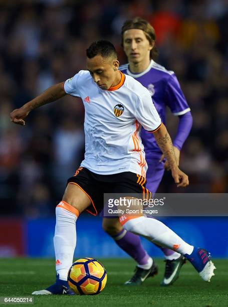 Fabian Orellana of Valencia competes for the ball with Luka Modric of Real Madrid during the La Liga match between Valencia CF and Real Madrid at...