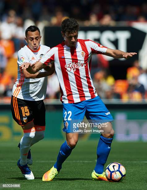 Fabian Orellana of Valencia competes for the ball with Mikel Vesga of Real Sporting de Gijon during the La Liga match between Valencia CF and Real...