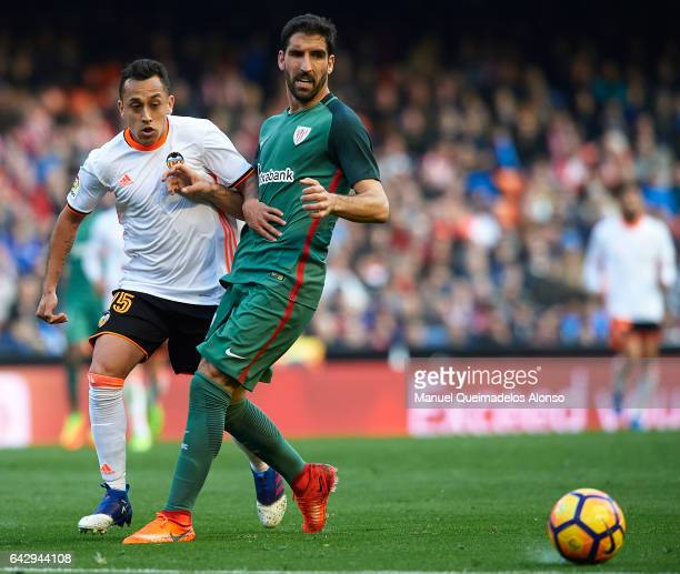 Fabian Orellana of Valencia competes for the ball with Raul Garcia of Athletic Club during the La Liga match between Valencia CF and Athletic Club at...