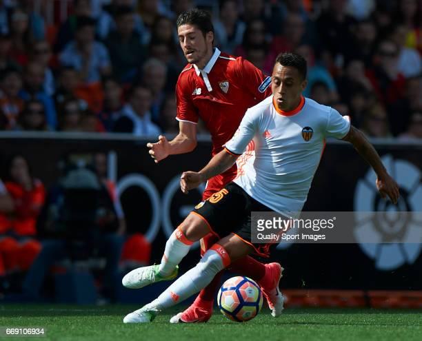 Fabian Orellana of Valencia competes for the ball with Sergio Escudero of Sevilla during the La Liga match between Valencia CF and Sevilla FC at...