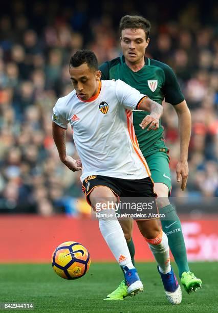 Fabian Orellana of Valencia puts pressure on Javier Eraso of Athletic Club during the La Liga match between Valencia CF and Athletic Club at Mestalla...