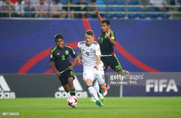 Fabian Reese of Germany beats Pablo Lopez and Eduardo Aguirre of Mexico during the FIFA U20 World Cup Korea Republic 2017 group B match between...