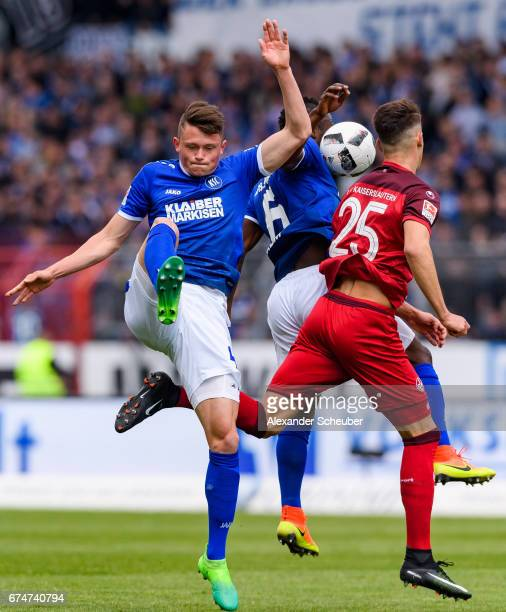 Fabian Reese of Karlsruhe challenges Robin Koch of FC Kaiserslautern during the Second Bundesliga match between Karlsruher SC and 1 FC Kaiserslautern...