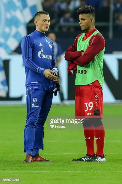 Fabian Reese of Schalke and Benjamin Henrichs of Leverkusen looks on during the Bundesliga match between FC Schalke 04 and Bayer 04 Leverkusen at...