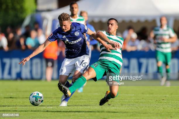 Fabian Reese of Schalke and Garcia of Eibar battle for the ball during the preseason friendly match between FC Schalke 04 and SD Eibar on July 30...