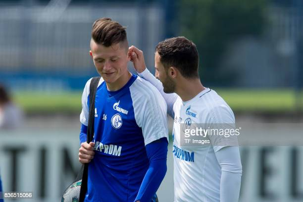 Fabian Reese of Schalke speak with Head coach Domenico Tedesco of Schalke gestures during a training session at the FC Schalke 04 Training center on...
