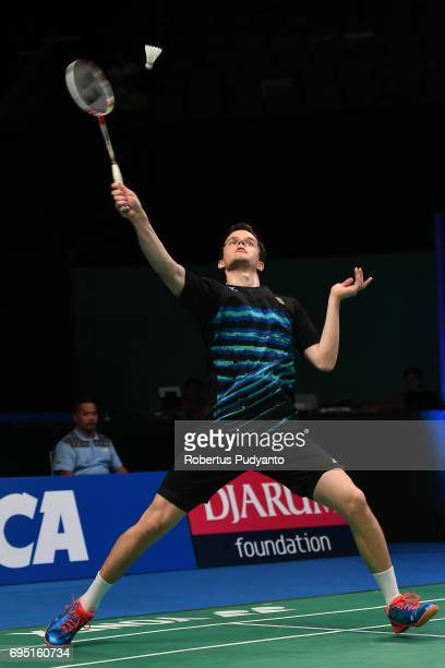 Fabian Roth of Germany competes against Wei Feng Chong of Malaysia during Mens single qualification round match of the BCA Indonesia Open Super...