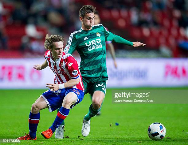 Fabian Ruiz Pena of Real Betis Balompie duels for the ball with Halilovic of Real Sporting de Gijon during the Copa del Rey Round of 32 match between...