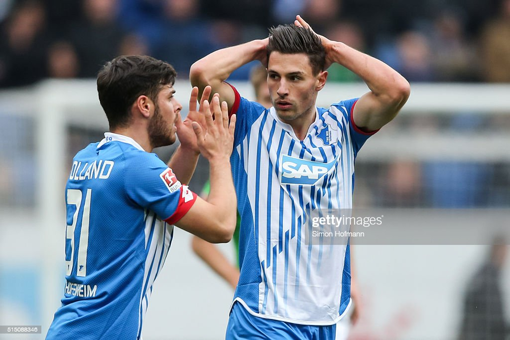 Fabian Schaer (R) and <a gi-track='captionPersonalityLinkClicked' href=/galleries/search?phrase=Kevin+Volland&family=editorial&specificpeople=6001755 ng-click='$event.stopPropagation()'>Kevin Volland</a> of Hoffenheim react during the Bundesliga match between 1899 Hoffenheim and VfL Wolfsburg at Wirsol Rhein-Neckar-Arena on March 12, 2016 in Sinsheim, Germany.