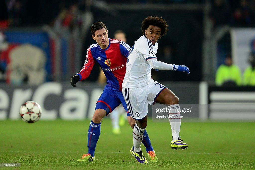 Fabian Schaer of Basel challenges <a gi-track='captionPersonalityLinkClicked' href=/galleries/search?phrase=Willian+-+Soccer+Player+for+Chelsea+and+Brazil&family=editorial&specificpeople=9886576 ng-click='$event.stopPropagation()'>Willian</a> of Chelsea during the UEFA Champions League Group E match between FC Basel 1893 and Chelsea at St. Jakob-Park on November 26, 2013 in Basel, Switzerland.