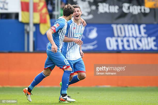 Fabian Schaer of Hoffenheim celebrates his team's first goal with team mate Tobias Strobl during the Bundesliga match between 1899 Hoffenheim and...