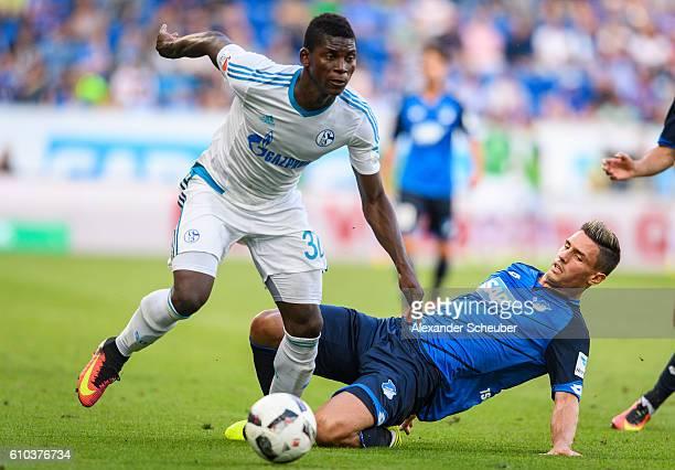 Fabian Schaer of Hoffenheim challenges Breel Emobolo of Schalke during the Bundesliga match between TSG 1899 Hoffenheim and FC Schalke 04 at Wirsol...