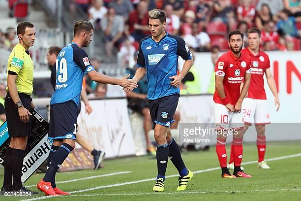 Fabian Schaer of Hoffenheim is replaced by Mark Uth during the Bundesliga match between 1 FSV Mainz 05 and TSG 1899 Hoffenheim at Opel Arena on...