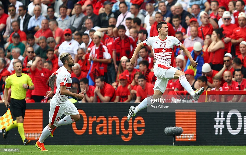 Fabian Schaer (R) of Switzerland celebrates scoring his team's first goal with his team mate <a gi-track='captionPersonalityLinkClicked' href=/galleries/search?phrase=Valon+Behrami&family=editorial&specificpeople=453450 ng-click='$event.stopPropagation()'>Valon Behrami</a> (L) during the UEFA EURO 2016 Group A match between Albania and Switzerland at Stade Bollaert-Delelis on June 11, 2016 in Lens, France.