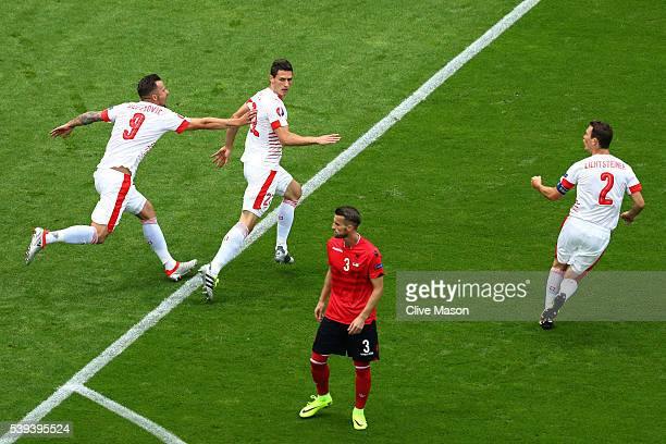 Fabian Schaer of Switzerland celebrates scoring his team's first goal with his team mates Haris Seferovic and Stephan Lichtsteiner during the UEFA...