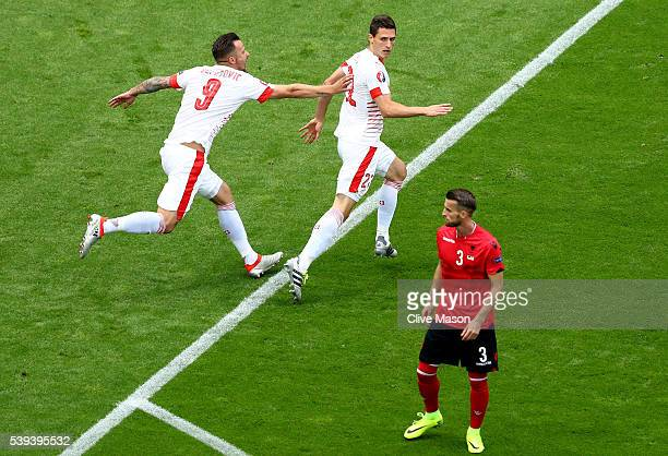 Fabian Schaer of Switzerland celebrates scoring his team's first goal with his team mate Haris Seferovic during the UEFA EURO 2016 Group A match...