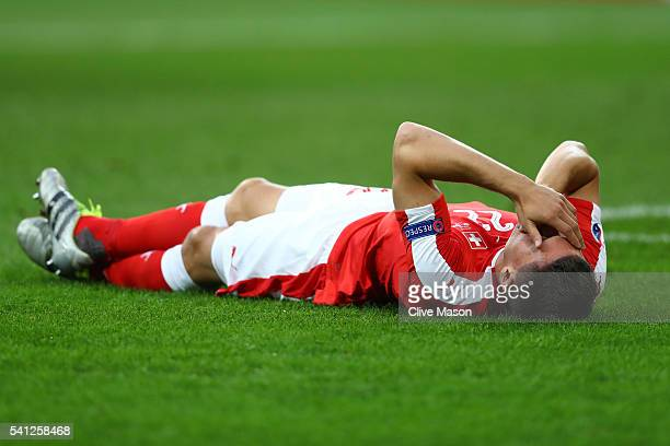 Fabian Schaer of Switzerland lies injured during the UEFA EURO 2016 Group A match between Switzerland and France at Stade PierreMauroy on June 19...