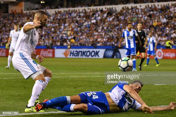 Fabian Schar of RC Deportivo La Coruna competes for the ball with Karim Benzema of Real Madrid during the La Liga match between Deportivo La Coruna...