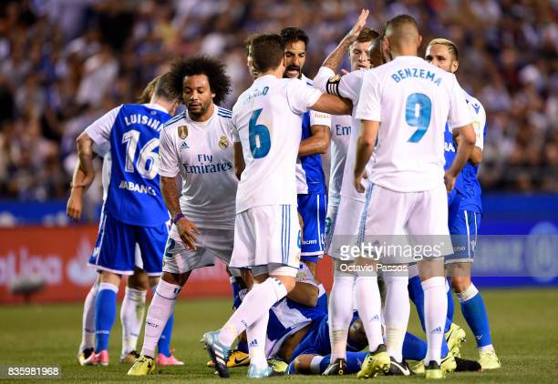 Fabian Schar of RC Deportivo La Coruna suffered a push of Sergio Ramos of Real Madrid during the La Liga match between Deportivo La Coruna and Real...