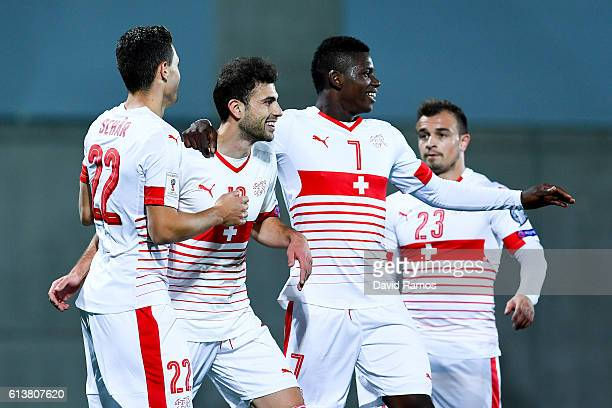 Fabian Schar of Switzerland celebrates with his team mates after scoring his team's first goal from the penalty spot during the FIFA 2018 World Cup...