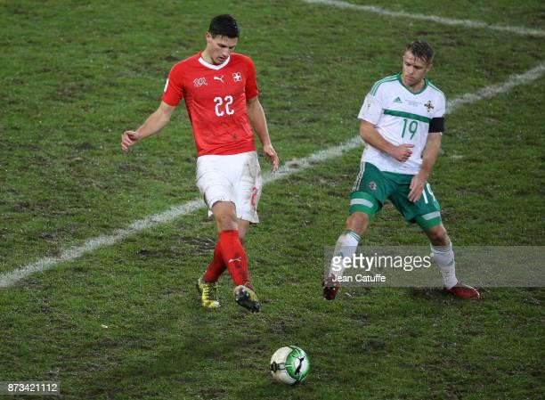 Fabian Schar of Switzerland Jamie Ward of Northern Ireland during the FIFA 2018 World Cup Qualifier PlayOff Second Leg between Switzerland and...