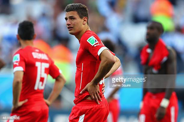 Fabian Schar of Switzerland looks dejected after a 01 defeat to Argentina in the 2014 FIFA World Cup Brazil Round of 16 match between Argentina and...