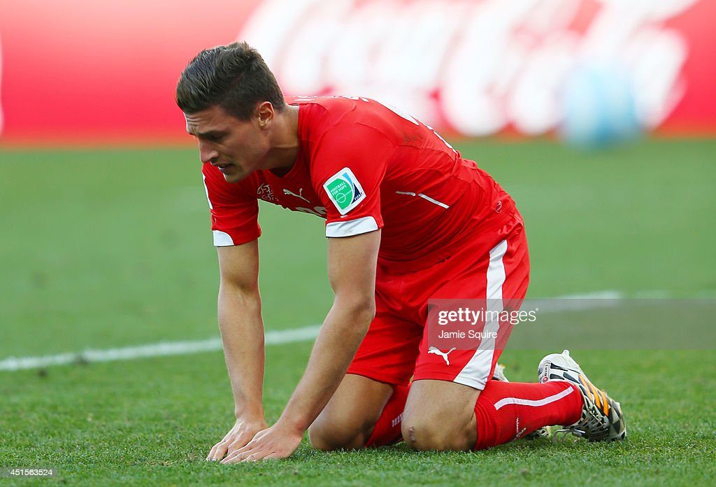 Fabian Schar of Switzerland reacts after a missed chance in extra time during the 2014 FIFA World Cup Brazil Round of 16 match between Argentina and Switzerland at Arena de Sao Paulo on July 1, 2014 in Sao Paulo, Brazil.