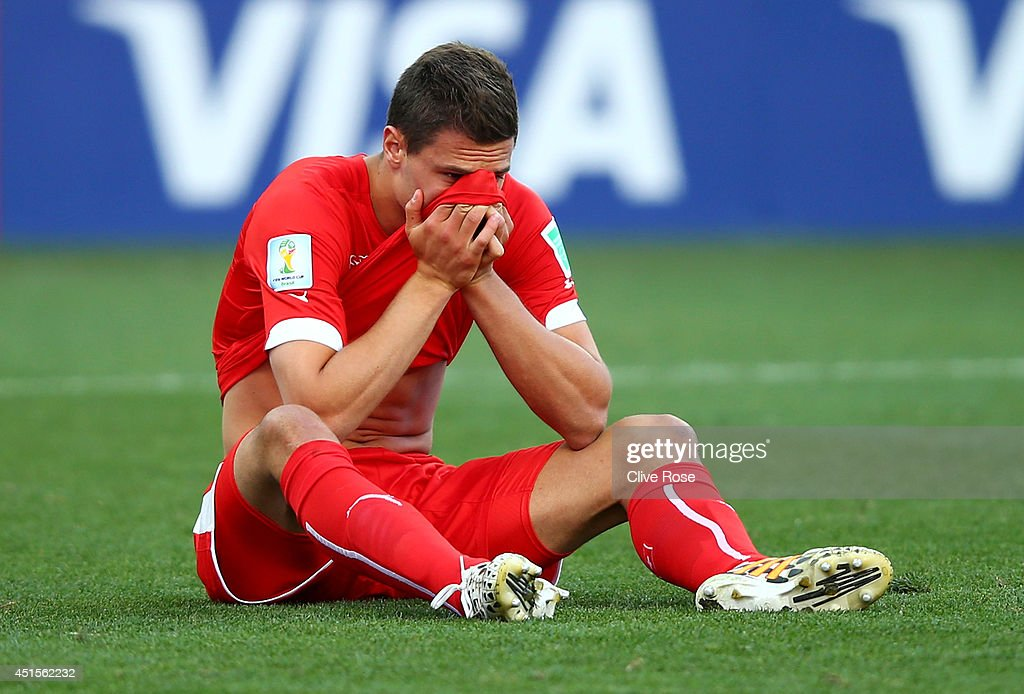 Fabian Schar of Switzerland reacts after being defeated by Argentina 1-0 in extra time during the 2014 FIFA World Cup Brazil Round of 16 match between Argentina and Switzerland at Arena de Sao Paulo on July 1, 2014 in Sao Paulo, Brazil.