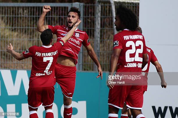 Fabian Schleusener of Frankfurt celebrates scoring the opening goal with his team mates during the 3 liga match between Sportfreudne Lotte and FSV...