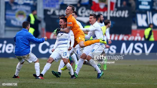 Fabian Schnellhardt of Duisburg celebrates the decision thrid goal with his team mates during the Third League match between MSV Duisburg and...