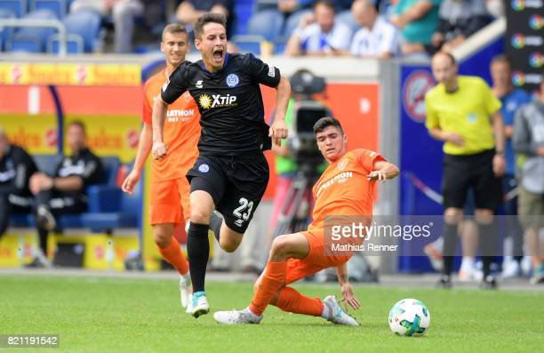 Fabian Schnellhardt of MSV Duisburg and Pablo Fornals of FC Malaga during the game between MSV Duisburg and FC Malaga on july 23 2017 in Duisburg...