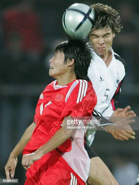 Fabian Schoenheim of Germany competes with Zhang Wenzhao of China during the U19 men's national football match between Germany and China at...