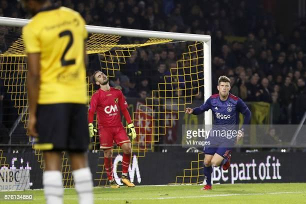 Fabian Sporkslede of NAC Breda goalkeeper Mark Birighitti of NAC Breda Klaas Jan Huntelaar of Ajax during the Dutch Eredivisie match between NAC...