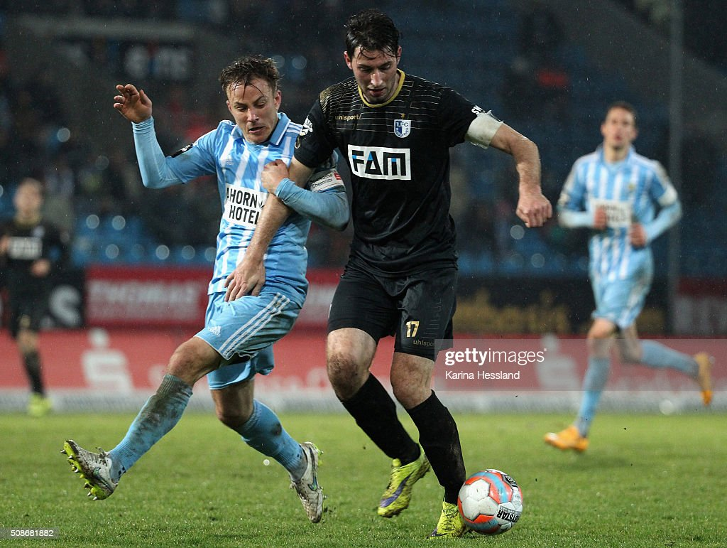 Fabian Stenzel of Chemnitz challenges Marius Sowislo of Magdeburg during the Third League match between Chemnitzer FC and 1.FC Magdeburg at Stadion an der Gellertstrasse on February 05, 2016 in Chemnitz, Germany.
