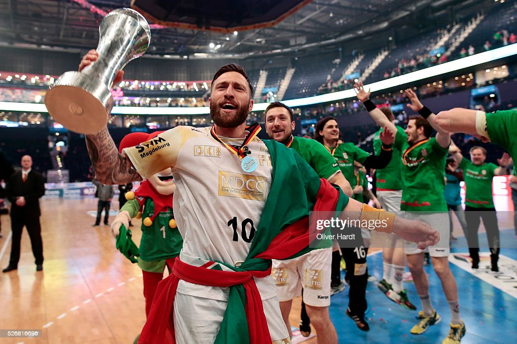 Fabian van Olphen of Magdeburg celebrate with the trophy after winning the DKB REWE Final Four Finale 2016 between SG Flensburg Handewitt and SC Magdeburg at Barclaycard Arena on May 1, 2016 in Hamburg, Germany.