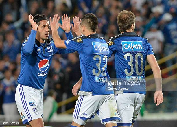Fabian Vargas of Millonarios celebrates with his teammates after scoring the first goal of his team during a match between Millonarios and Jaguares...