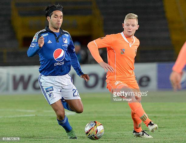 Fabian Vargas of Millonarios fights for the ball with George Saunders of Envigado FC during a match between Millonarios and Envigado as part of Liga...