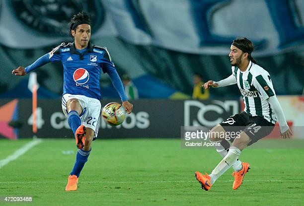 Fabian Vargas of Millonarios struggles for the ball with Sebastian Perez of Atletico Nacional during a match between Millonarios and Atletico...