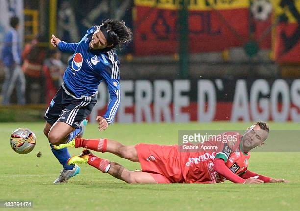 Fabian Vargas of Millonarios struggles for the ball with Sebastian Acosta of Patriotas FC during a match between Patriotas FC and Millonarios as part...