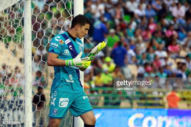 Fabian Villasenor goalkeeper of Puebla spits on his glove during the 15th round match between Leon and Puebla as part of the Torneo Clausura 2017...