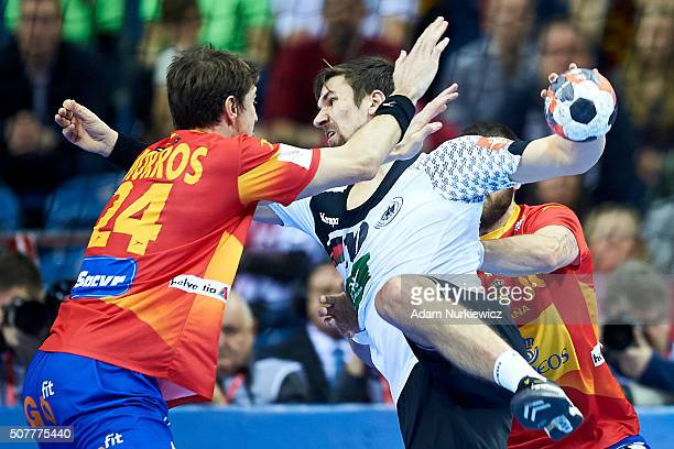 Fabian Wiede from Germany throws the ball against Viran Morros de Argila from Spain during the Men's EHF Handball European Championship 2016 Final...