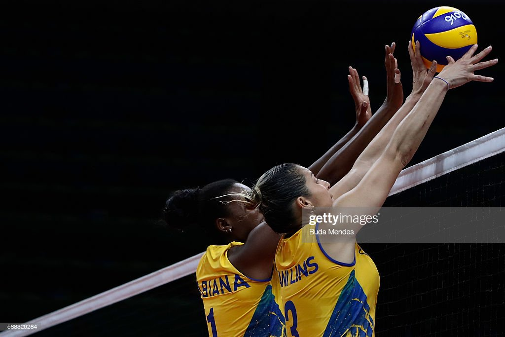 Fabiana Claudino #1 of Brazil and Dani Lins #3 block the ball during the women's qualifying volleyball match between theBrazil and Japan on Day 5 of the Rio 2016 Olympic Games at the Maracanazinho on August 10, 2016 in Rio de Janeiro, Brazil.