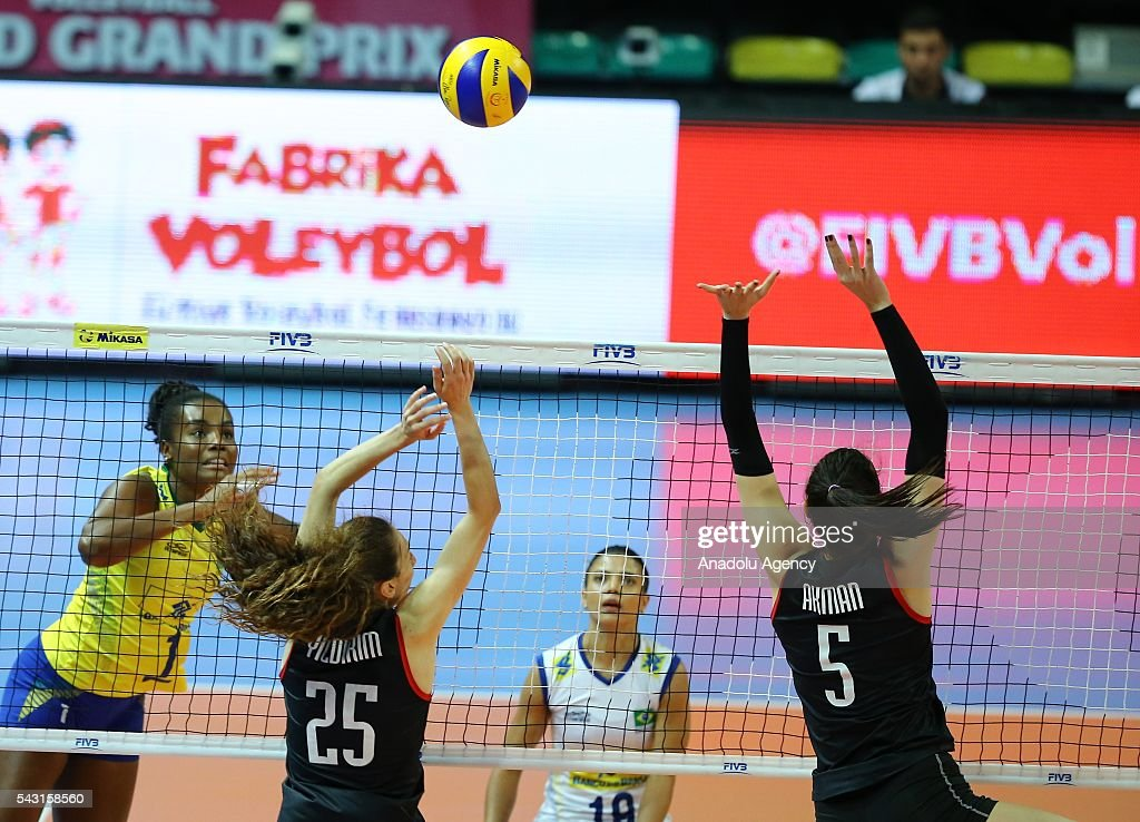 Fabiana Claudino (L) of Brazil in action during the 2016 FIVB Volleyball World Grand Prix Women's match between Turkey and Brazil at the TVF Baskent Sports Hall in Ankara, Turkey on June 26, 2016.