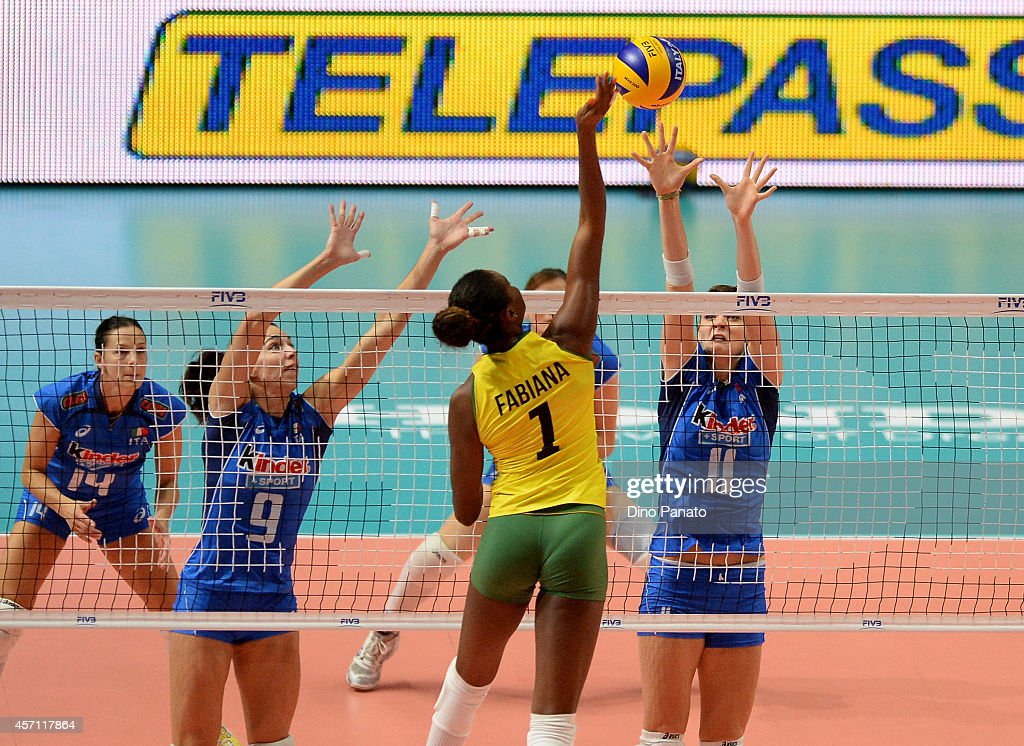 <a gi-track='captionPersonalityLinkClicked' href=/galleries/search?phrase=Fabiana+Claudino&family=editorial&specificpeople=2151767 ng-click='$event.stopPropagation()'>Fabiana Claudino</a> of Brazil spikes the ball against to Cristina Chirichella and <a gi-track='captionPersonalityLinkClicked' href=/galleries/search?phrase=Nadia+Centoni&family=editorial&specificpeople=2309657 ng-click='$event.stopPropagation()'>Nadia Centoni</a> of Italy during the FIVB Women's World Championship 3rd Place Playoff match between Italy and Brazil on October 12, 2014 in Milan, Italy.