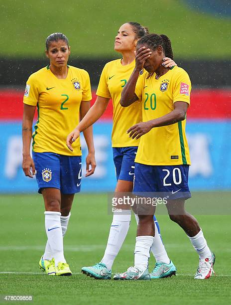 Fabiana Monica and Formiga of Brazil look dejected in defeat after the FIFA Women's World Cup 2015 round of 16 match between Brazil and Australia at...
