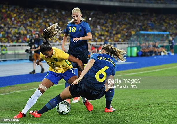 Fabiana of Brazil is challenged by Magdalena Eriksson of Sweden during the Olympic Women's Football match between Brazil and Sweden at Olympic...