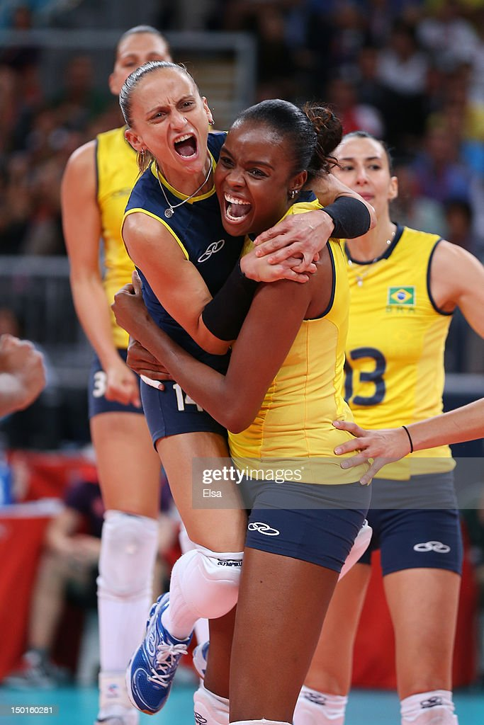 Fabiana Oliveira #14 and Fabiana Claudino #1 of Brazil react after a point against United States during the Women's Volleyball gold medal match on Day 15 of the London 2012 Olympic Games at Earls Court on August 11, 2012 in London, England.