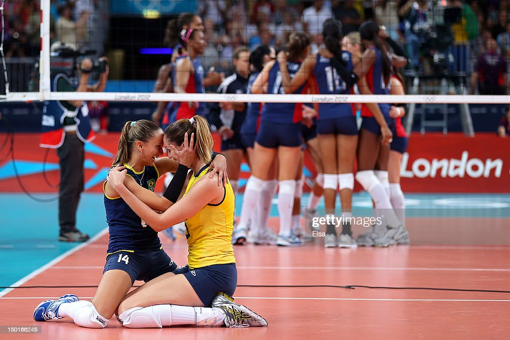 Fabiana Oliveira #14 and Thaisa Menezes #6 of Brazil of Brazil reacts after defeating the United States to win the Women's Volleyball gold medal match on Day 15 of the London 2012 Olympic Games at Earls Court on August 11, 2012 in London, England.