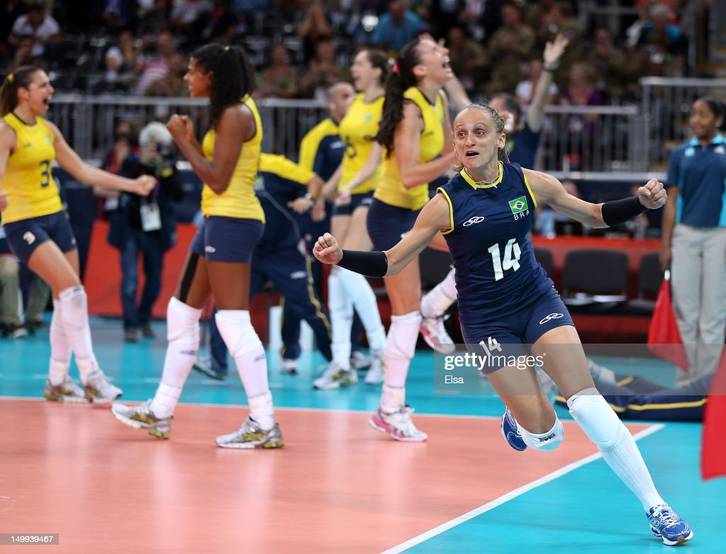 Fabiana Oliveira #14 of Brazil celebrates the win over Russia during Women's Volleyball quarterfinals on Day 11 of the London 2012 Olympic Games at Earls Court on August 7, 2012 in London, England.