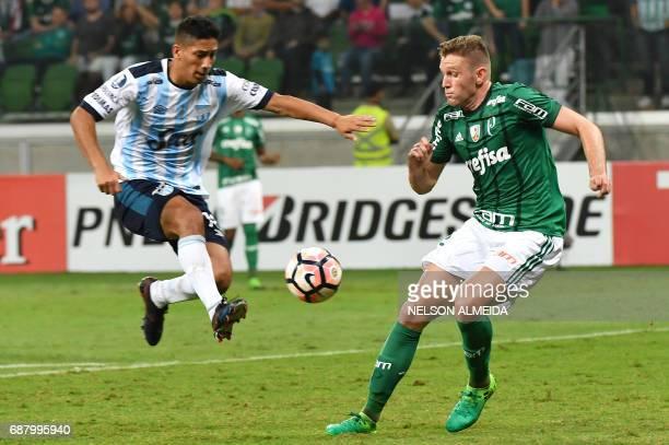 Fabiano of Brazil's Palmeiras vies for the ball with Franco Quiroga of Argentina's Atletico Tucuman during their 2017 Copa Libertadores football...